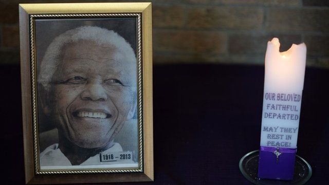Photograph of Nelson Mandela next to a candle