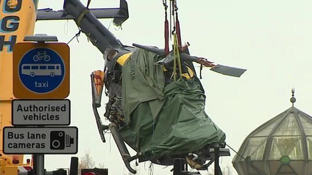 The helicopter being lifted from the crash site