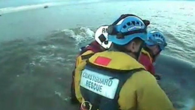 Rescuers in the water