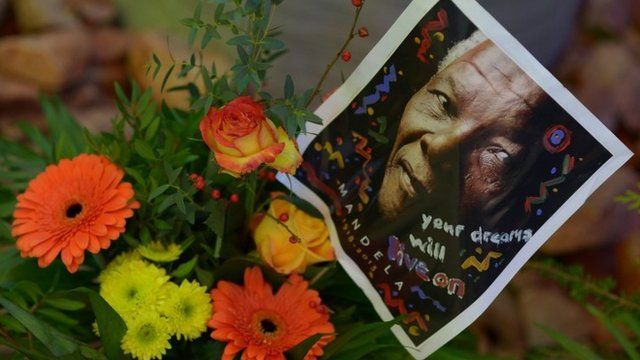 Flowers and a photo of former South African President Nelson Mandela