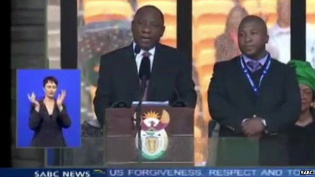 Still from SABC TV of two sign language interpreters