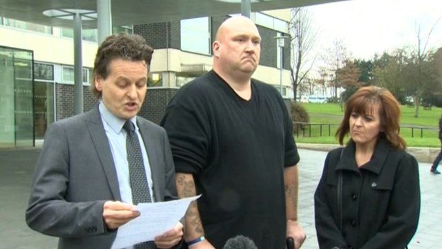 Nigel Verdon, centre, with his wife and solicitor outside Mold Crown Court
