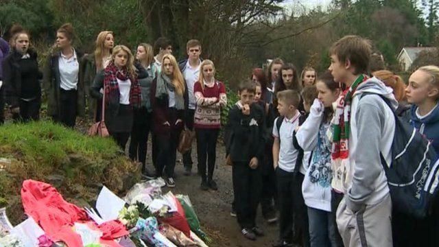 Pupils at Pembroke School, Pembrokeshire, pay tribute to Derek Brundrett, 14, found hanged nearby.