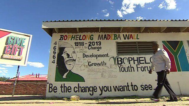 Man walking past 'Madiba wall'