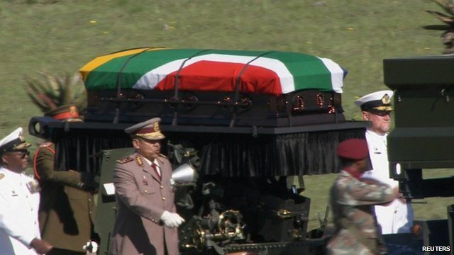 Nelson Mandela's coffin is transported to his funeral in Qunu, South Africa