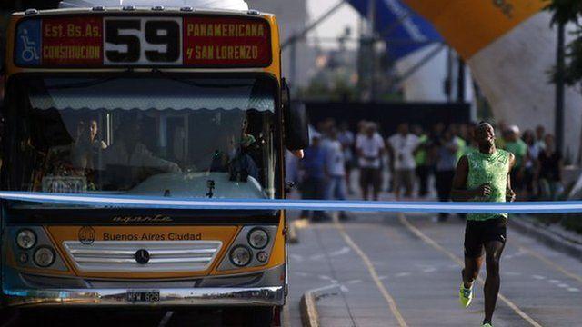 Usain Bolt racing bus