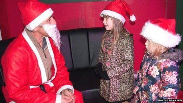 One of the Santas seeing two children