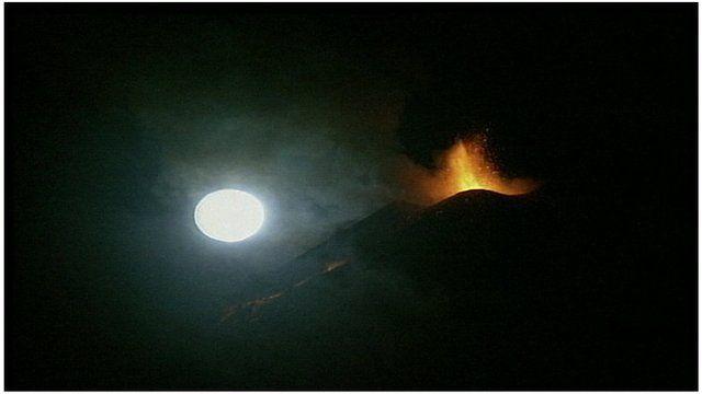 Mount Etna eruption in view of moon