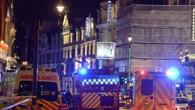 Emergency vehicles outside the Apollo Theatre
