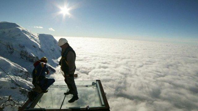 Workmen complete mountain top glass platform