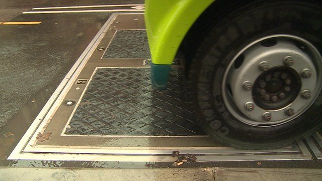The bus recharges wirelessly over plates buried in the road