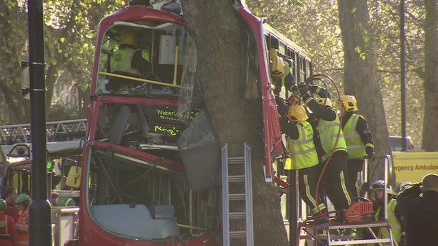 A double-decker bus which hit a tree in south London