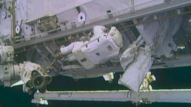 Astronaut working on exterior of International Space Station