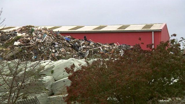 Waste pile next to warehouse