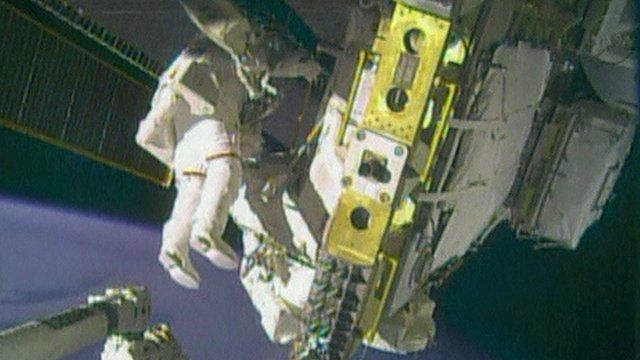 Astronauts Rick Mastracchio and Mike Hopkins on spacewalk outside the ISS
