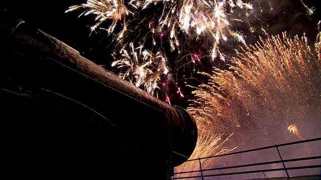 Fireworks seen near a cannon at Edinburgh Castle