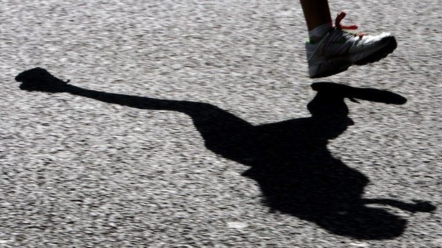 Runner casts a shadow