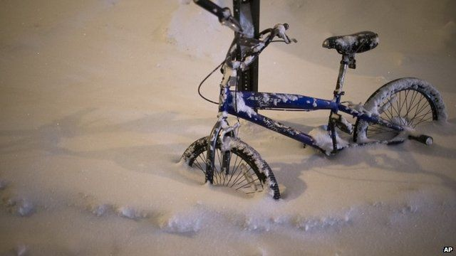 A bicycle is buried by snow in the Queens borough of New York.