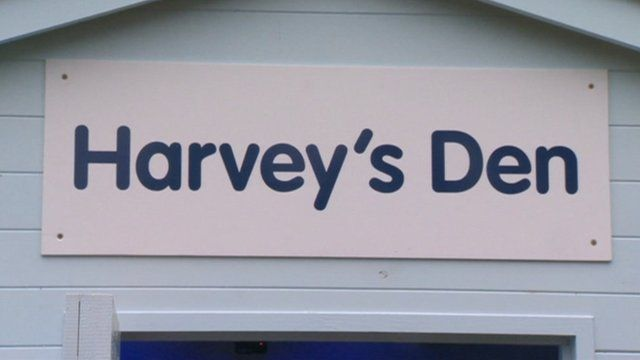 Harvey's Den sign