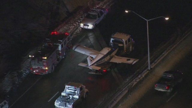 Aerial view of small plane on back of truck