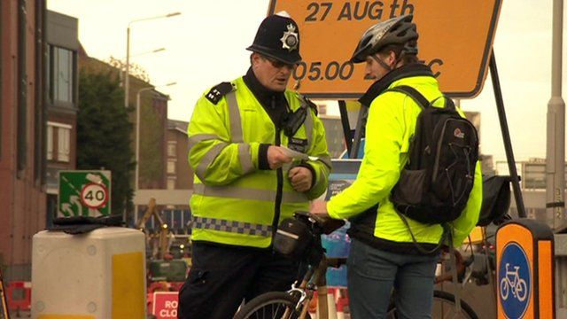 Police officer speaking to a cyclist