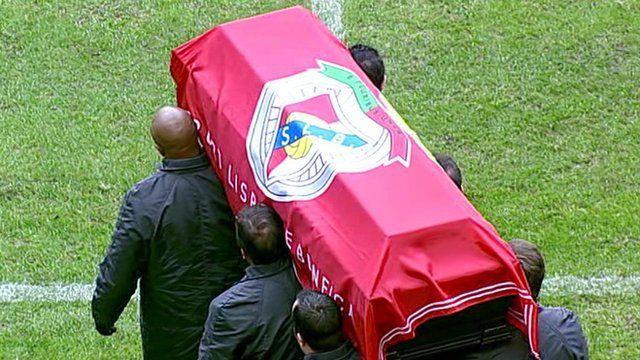 Eusebio da Silva Ferreira's coffin being carried onto Lisbon football stadium
