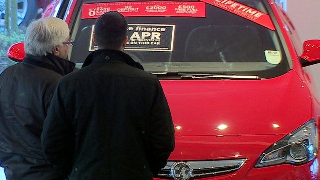 People viewing a car for sale