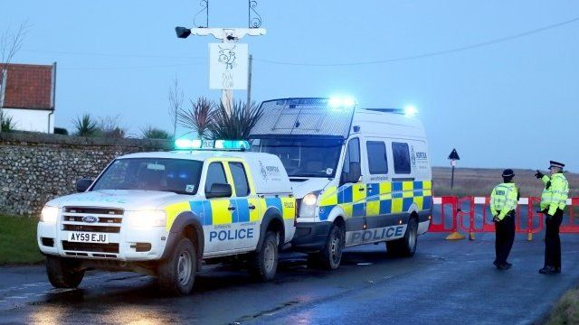 A Police road block at Salthouse in Norfolk following a helicopter crash near Cley-next-the-Sea