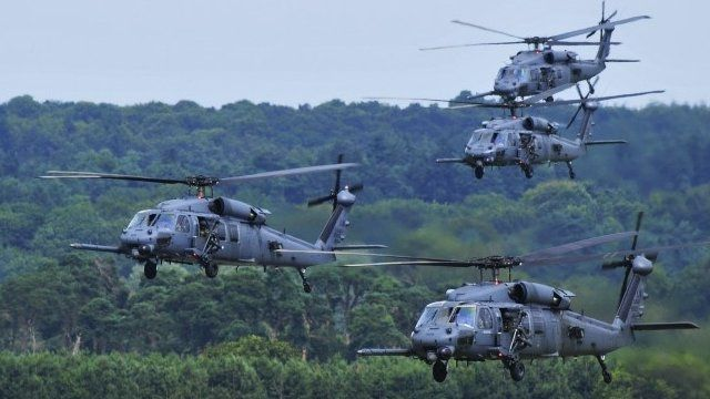A four-ship fleet of 56th Rescue Squadron HH-60G Pave Hawks flying over RAF Lakenheath