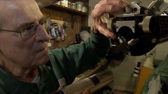 Inventor John Wall fitting eyepiece to telescope
