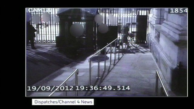 CCTV of Andrew Mitchell at Downing Street gate with bike