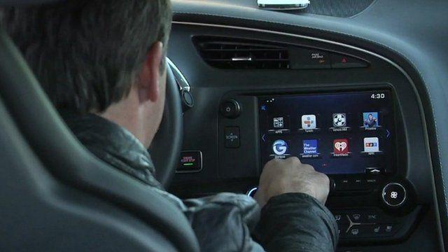 Man looking at car display panel