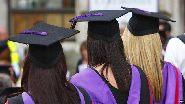 Three girls attending a graduation ceremony