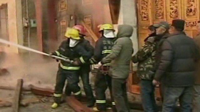 Tibetan fire service putting out flames