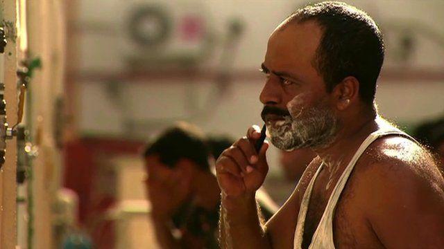 Migrant worker shaving