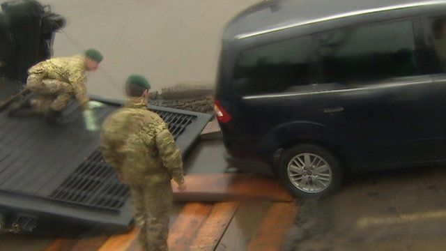 Royal Marines removing the cars