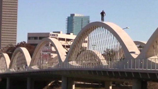 BMX rider on arches of bridge
