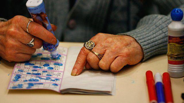 An elderly woman playing bingo