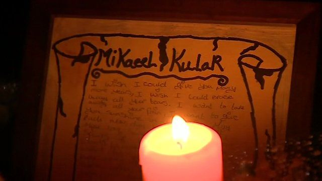 Candle and tribute for Mikaeel Kular