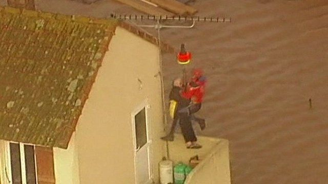 A man is rescued from his home