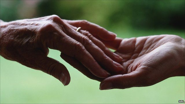 Two people touch hands