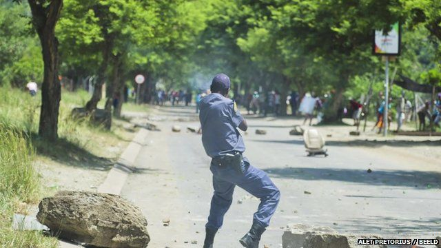 Policeman shoots weapon