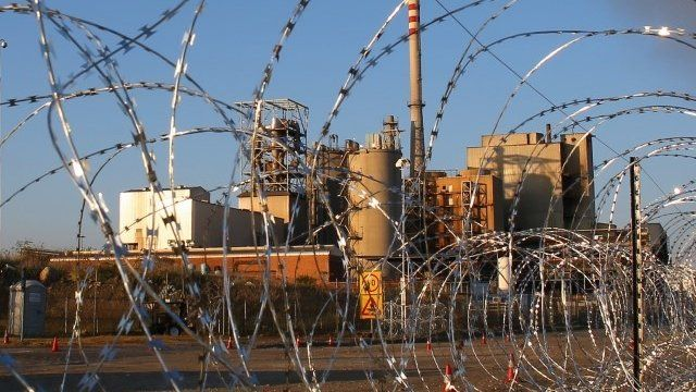 Barbed wire at the entrance to Lonmin's platinum mine in Marikana