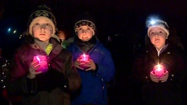 Children holding candles