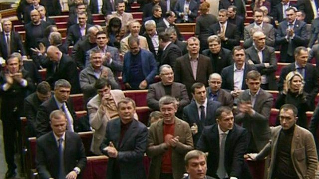 Politicians cheering as law passed