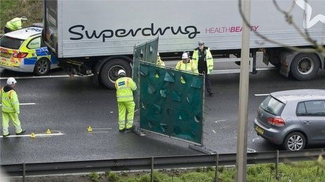 Police investigating the scene of the incident on the M1