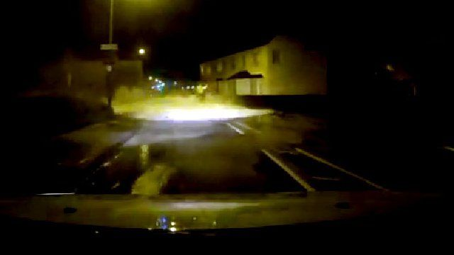 Driver films police officer being swept away by a wave