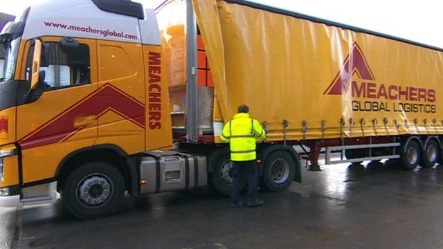 Lorries deliver their goods to a collection point on the edge of Southampton