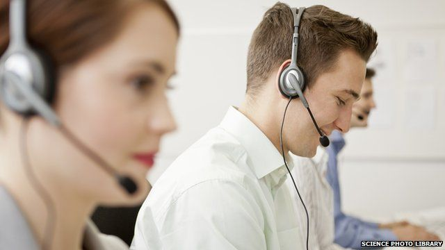 Business people working in headsets.