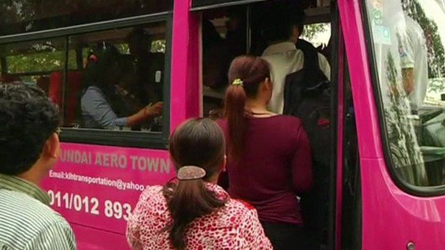 People queuing to board bus